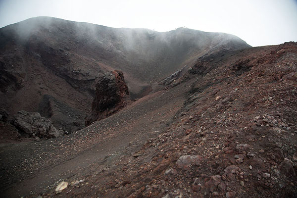 The black and red landscape of of the Barbagallo crater on the south side of Mount Etna | Mount Etna summit hike | Italy