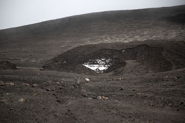 Foto van Snow visible under the volcanic slope of Mount EtnaMount Etna - Italië