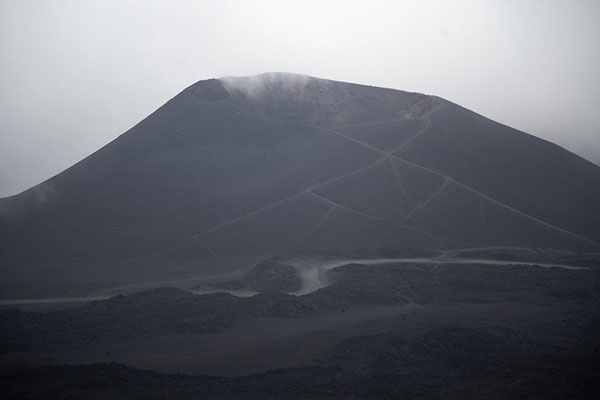 Foto van One of the many cones sticking out of the landscape on the south side of Mount EtnaMount Etna - Italië