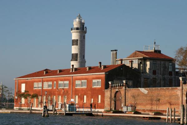 Picture of Early morning light on the lighthouse and canal of Murano
