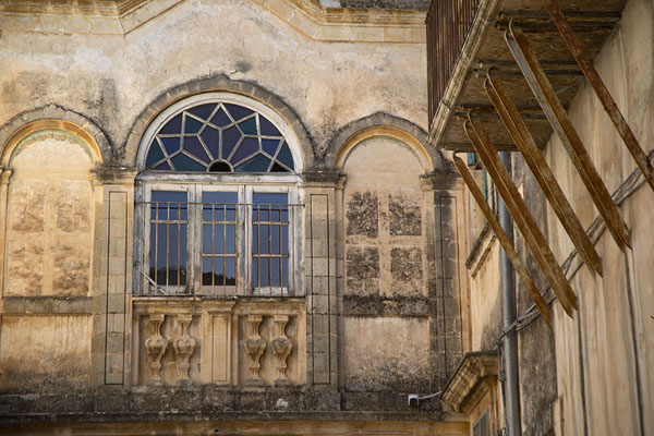 Balcony and window in a one of the many 18th century buildings in Noto | Noto | Italy