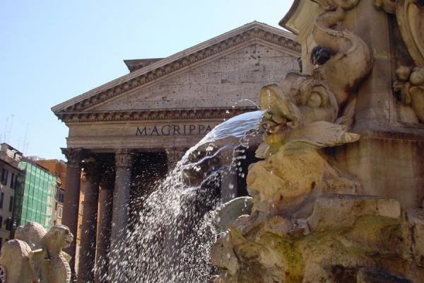 Part of the Pantheon from behind the fountain in front of it | Pantheon | Italy