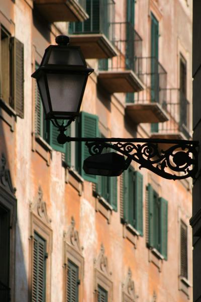 Lantern and window shades in Pigna district, Rome | Pigna | Italy