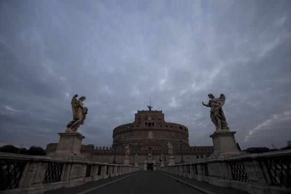 Looking towards Castel Sant'Angelo with two statues in the foreground | Ponte Sant'Angelo | Italy