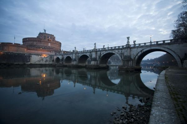 Arches of the Ponte Sant'Angelo reflected in the waters of the Tiber river | Ponte Sant'Angelo | Italy