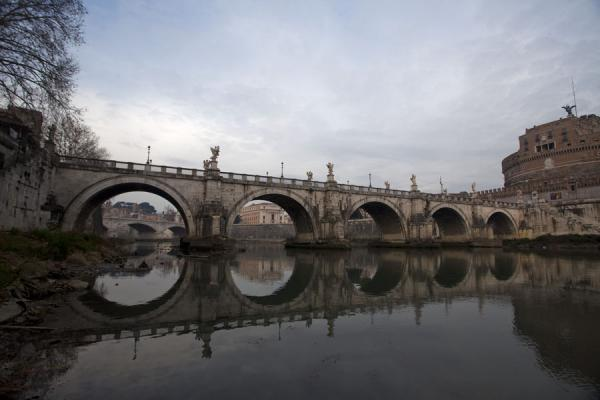 Arches of the Ponte Sant'Angelo reflected in the Tiber river | Ponte Sant'Angelo | Italy