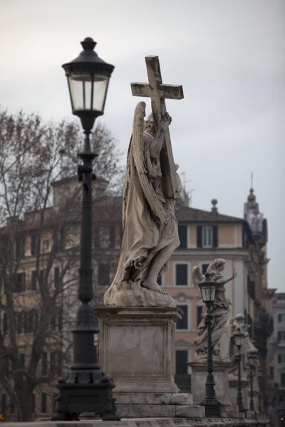 Cross-carrying statue and street lantern on the Ponte Sant'Angelo | Ponte Sant'Angelo | Italy