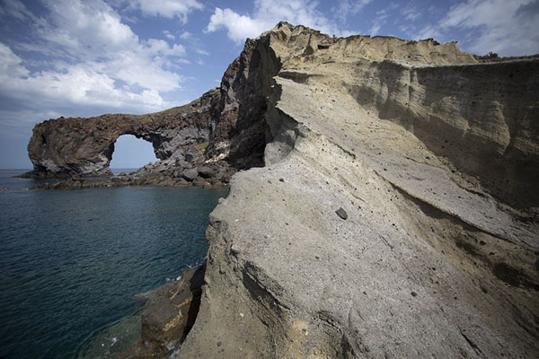 Rock formations and natural arch at the west coast of Salina, near Pollara | Salina | Italië