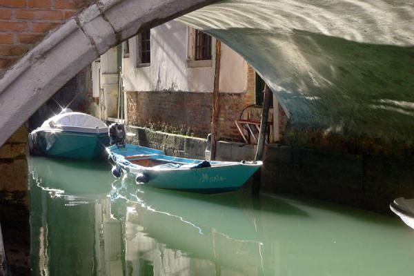 Picture of Boat under a bridge in Venice - Italy - Europe