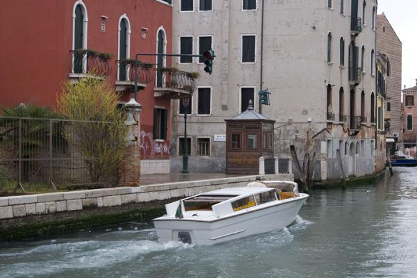 Boat in a canal in Venice | Venetian Canals | Italy