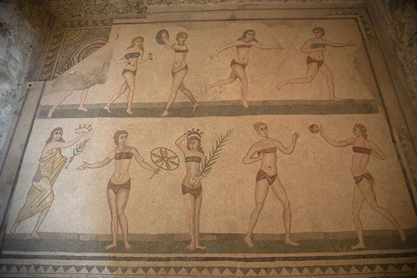 Girls in bikini doing sports: one of the famous mosaics of the villa | Villa Romana del Casale | Italy
