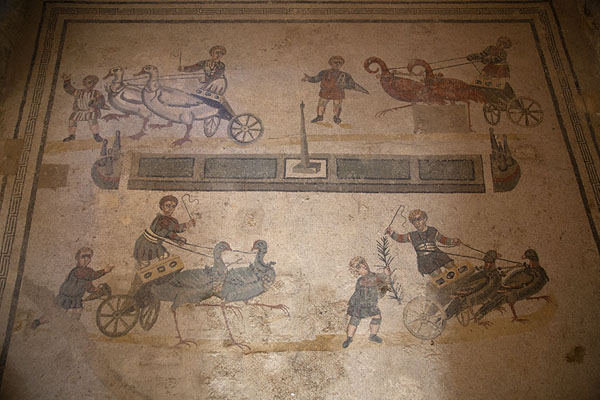 Children racing chariots driven by birds, with one winner | Villa Romana del Casale | Italy
