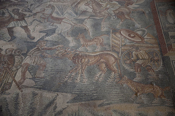 Hunters wading through water with their animals in the hunting mosaic | Villa Romana del Tellaro | Italy