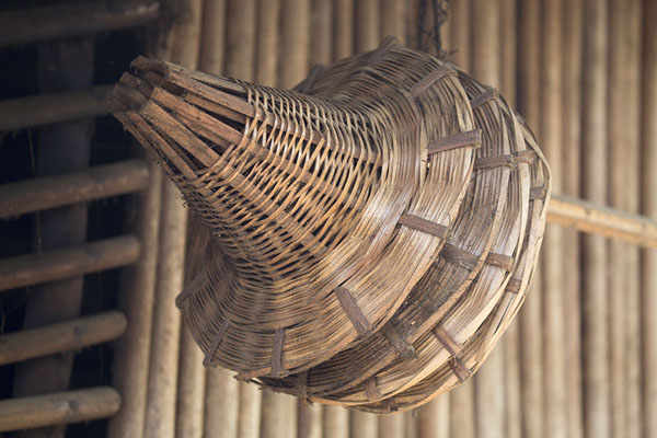 Fishing baskets hanging from a traditional hut on the Bandama river | Azagny National Park | Ivory Coast