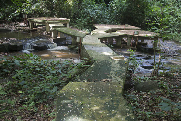 Concrete walkway over the streams below the waterfall | Cascades de Man | Ivory Coast