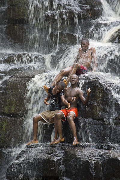 Boys showing off in the waterfall | Cascades de Man | Côte d'Ivoire