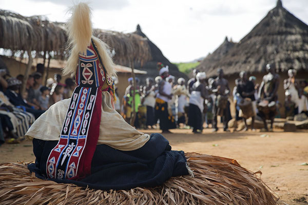 Mask dancer sitting in Gboni | Gboni stilt dancing | Ivory Coast