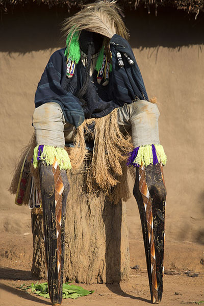 Stilt dancer taking a rest before performing his incredible dance | Gboni stilt dancing | Ivory Coast