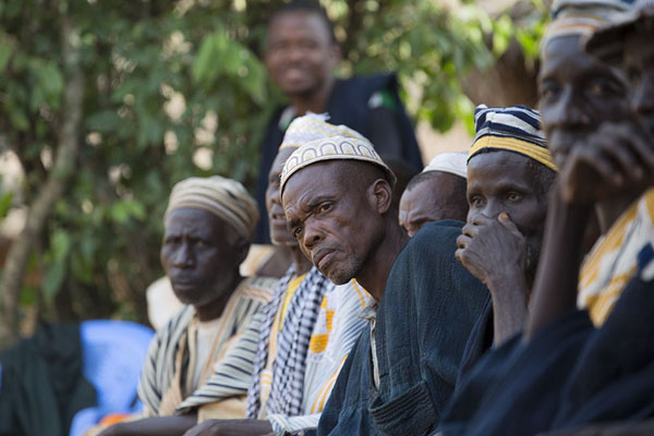 The old men of Gboni watching the youngsters of the village dance | Gboni stilt dancing | Costa Marfil