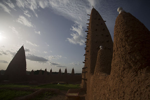 View of the crenellated wall and towers at the roof of the mosque of Kong | Kong mosque | Ivory Coast