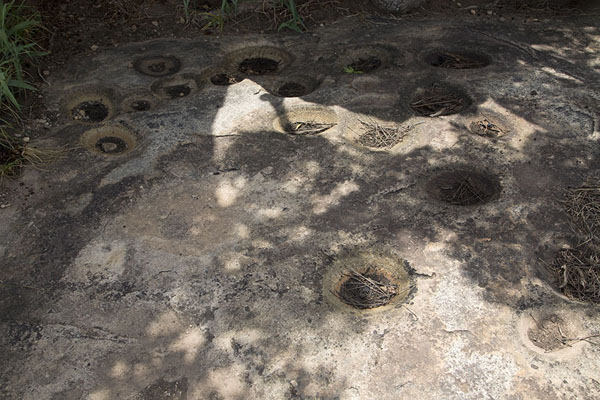 Foto di Natural holes in a rocky floor near the sacrificial site - Costa d'Avorio - Africa