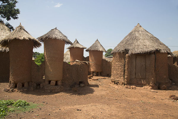 Picture of Rows of container huts and huts where villagers liveNiofoin - Ivory Coast
