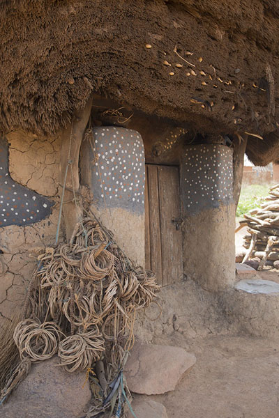 Picture of Niofoin (Ivory Coast): Entrance of the Diby house, with necklaces of sacrificed dogs next to the door