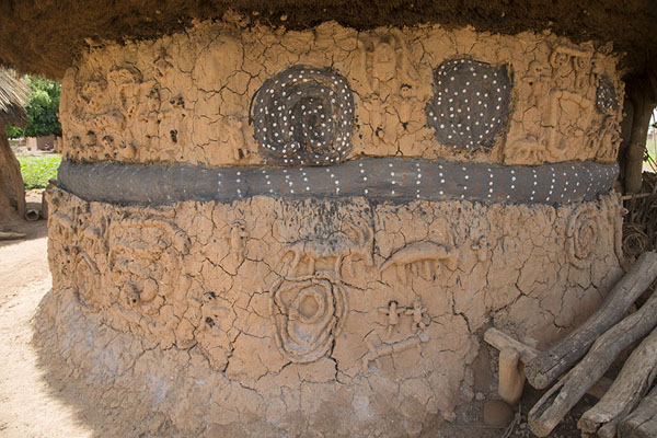 Picture of Niofoin (Ivory Coast): The Diby fetish house is decorated on the outside with snakes, other animals, and human figures