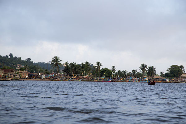 The shoreline of Sassandra river with many Ghanaian fishing boats docked on the coast | Sassandra | Costa Marfil