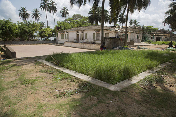 Remains of a swimming pool and tennis courts of what used to be a posh hotel in Sassandra | Sassandra | Ivory Coast