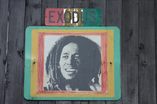 Image of Bob Marley surrounded by Rasta colours, with the title of one of his albums | Mausolée Bob Marley | Jamaique
