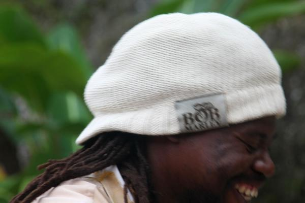 Picture of Joyful Rasta guide having a laugh at Bob Marley MausoleumNine Mile - Jamaica