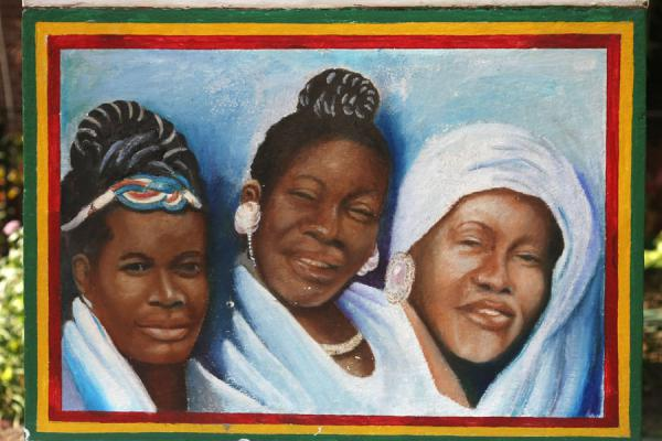 Foto di Three women important in the life of Bob Marley at the socle of his statueKingston - Giamaica