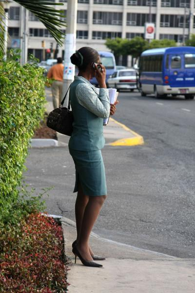 Picture of Jamaican lady making a phone call in the streets of Kingston