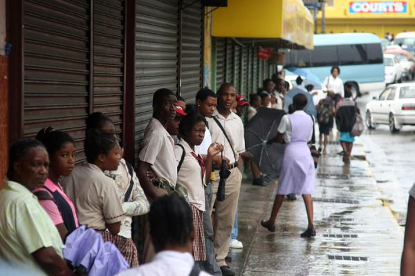 Waiting for the rain to pass in Montego Bay | Jamaican people | 牙买加
