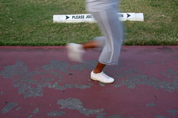 Picture of Jamaican woman jogging in Emancipation ParkKingston - Jamaica