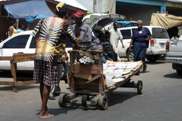 Man with a pushcart at the market of Kingston | Marché de Kingston | Jamaique