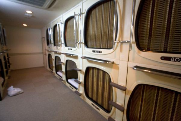 Occupied bunks in a capsule hotel | Capsule Hotel | Japan