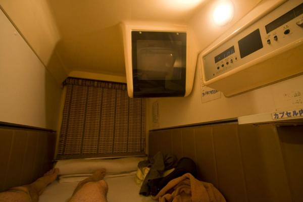 Picture of Interior of capsule hotel bunk: TV, radio, air conditioning, light