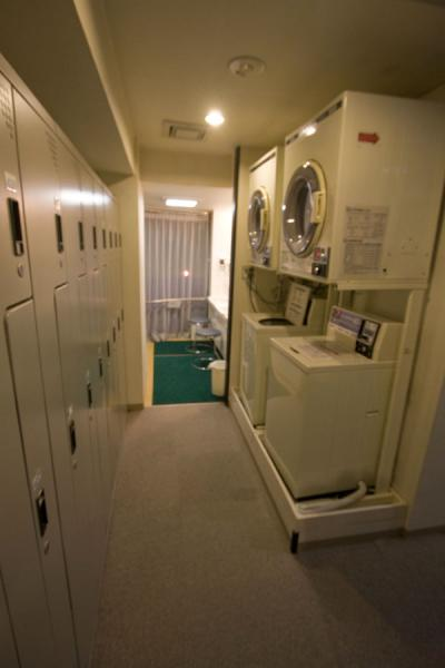 Interior of capsule hotel: laundry machines | Capsule Hotel | Japan