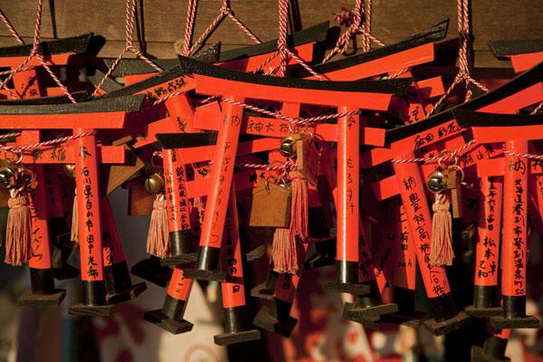 Picture of Fushimi Inari-taisha (Japan): Miniature torii tied together into bundles at a shrine