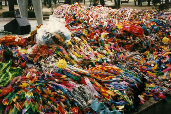 Thousands of coloured paper cranes at the foot of the Childrens Peace Monument | Peace Memorial Park | Japan