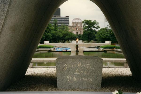 Picture of Peace Memorial Park (Japan): Small pond and eternal flame visible through the Memorial Cenotaph