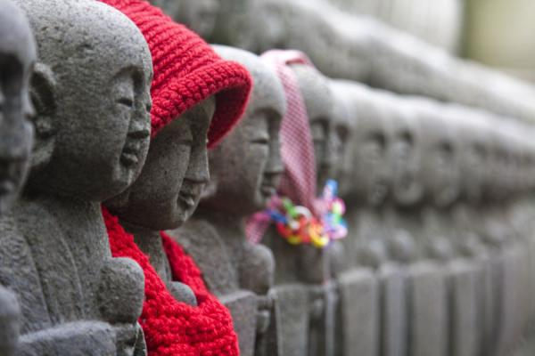 Picture of Stone statues, some of them dressed up, at Hase-dera temple complex