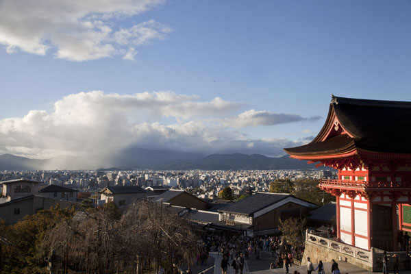 The Gate of the Deva Kings and the city of Kyoto and surrounding mountains in the background | Kiyomizu-dera | Japan
