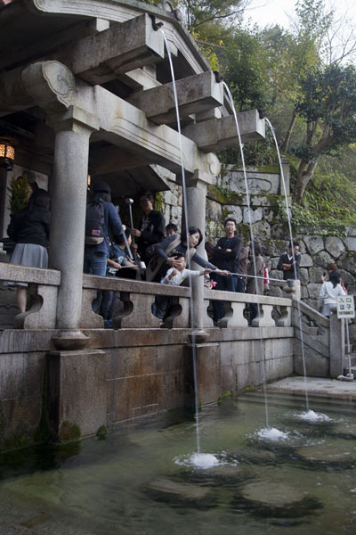 Picture of Visitors drinking water from Otowa-no-taki waterfall, bringing them a long life, good health, and success in studies - Japan - Asia
