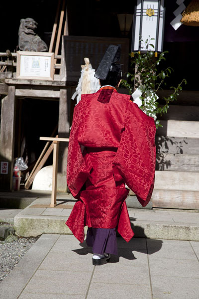 Picture of Priest in red robe at Yuki shrineKurama - Japan