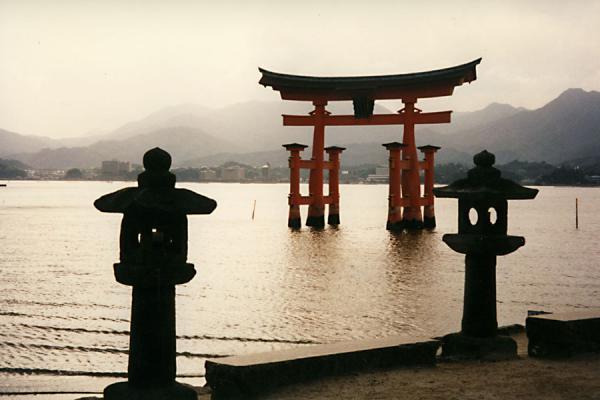 Picture of Miyajima (Japan): Stone lanterns and the famous torii of Itsukushima Shrine