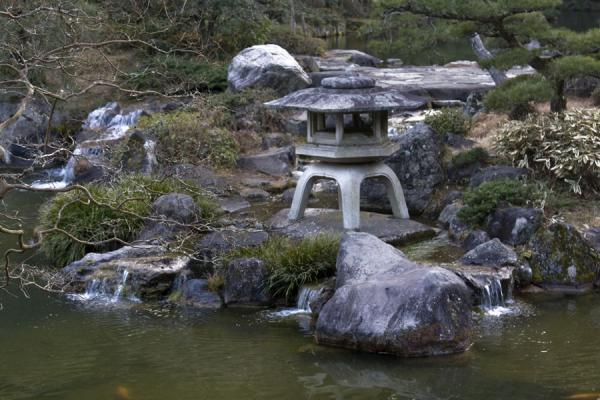 Picture of Rocks and small stone pagoda at one of the ponds in the park of Narita-san