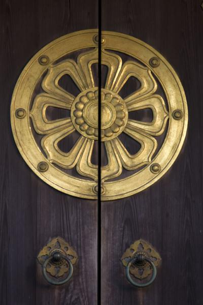 Decorated wooden door of Komyodo Hall | Narita-san Shinsho-ji temple | Japan